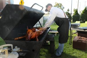 Cheer Green Bay Employees With a Pig Roast
